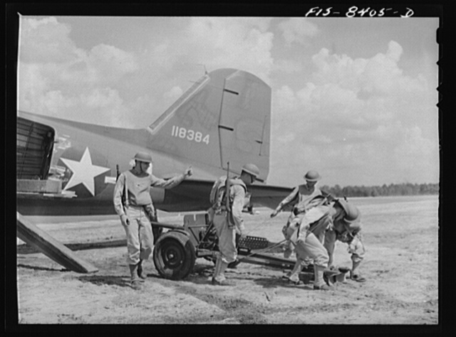 Fort Bragg, North Carolina. Unloading a 37mm gun from a transport plane in a military demonstration