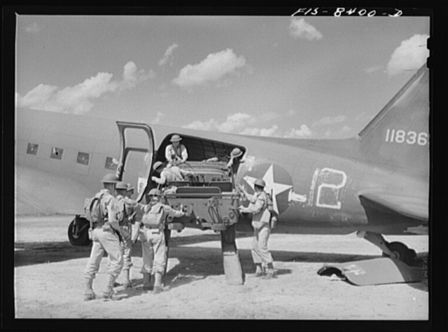 Fort Bragg, North Carolina. Unloading a jeep from a transport plane in a military demonstration