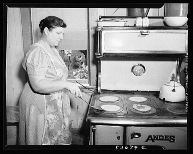 Fort Kent, Maine. (vicinity). Mrs. [Leonard] Gagnon making buckwheat pancakes