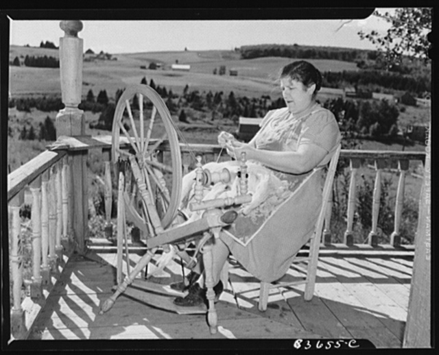 [Fort Kent, Maine (vicinity). Wife of Albert [Leonard] Gagnon, Acadian FSA (Farm Security Administration) client, spinning domestic wool for knitting]