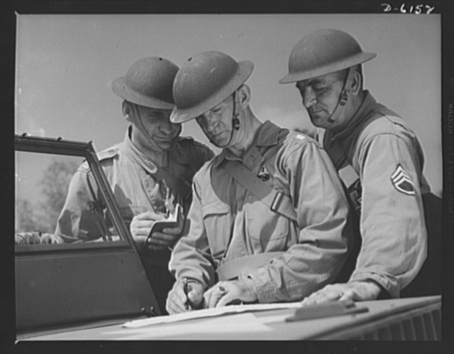 Fort Knox. Armored force personnel. A captain, a lieutenant-colonel and a staff sergeant of the armored forces discuss tactical problems during war games at Fort Knox, Kentucky, where soldiers in training are learning the most up-to-date methods of fighting a mechanized war