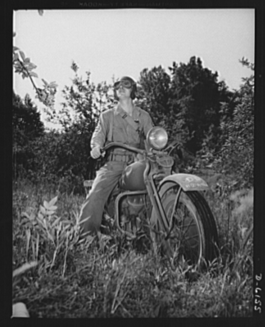 Fort Knox. Armored force personnel. A first sergeant of the armored forces pulls his motorcycle to a standstill to study the effect of a tactical move during war games at Fort Knox, Kentucky, where young soldiers are learning the latest tricks of mechanized warfare