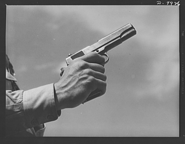Fort Knox. Colt automatic pistol. A soldier in training at Fort Knox, Kentucky, demonstrates the use of one of America's renowned weapons, a Colt pistol. Much changed in appearance from the gun that was famous on our frontiers nearly a century ago, this .45 caliber automatic is one of the standard weapons of our modern Army