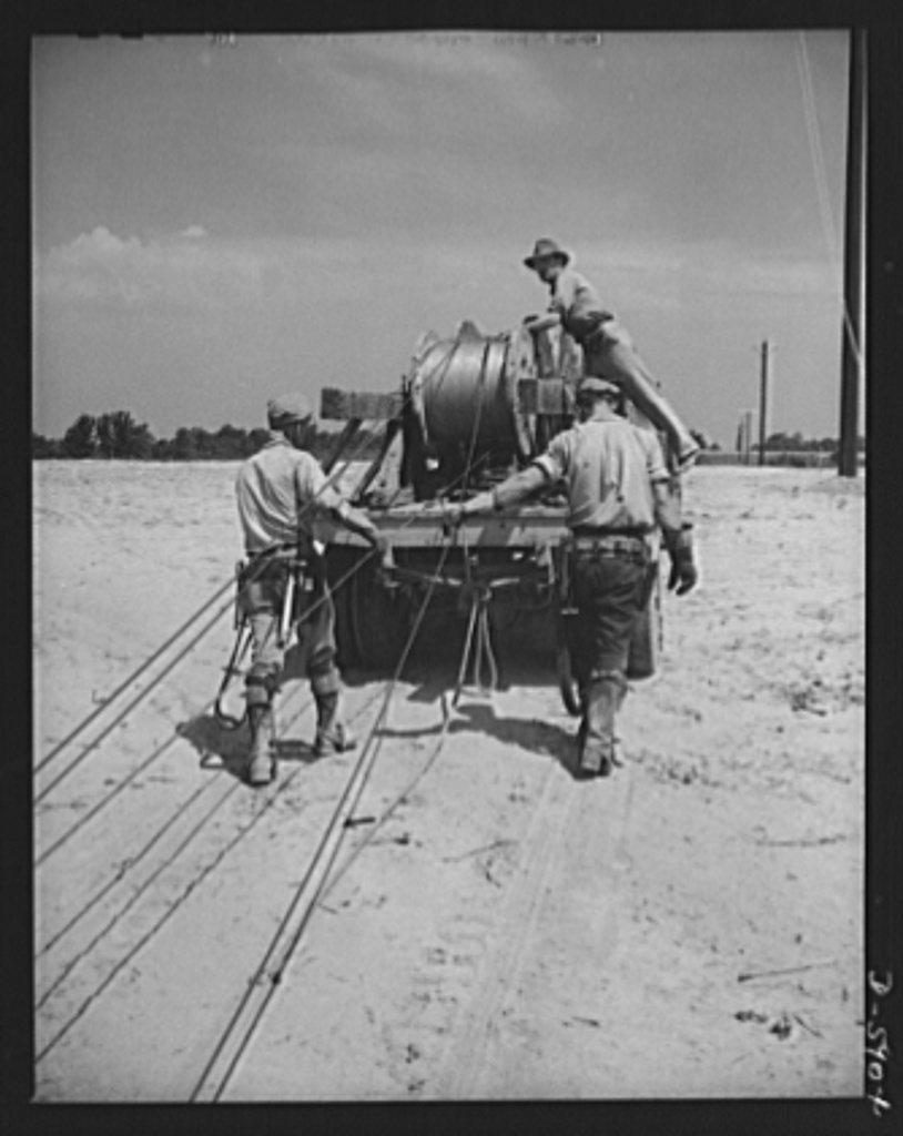 Fort Knox. Electric power line construction. A new electric power line for the Army. A pole line crew of a large construction company extends service into Fort Knox, Kentucky, where American soldiers are training and hardening for modern warfare