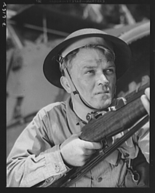 Fort Knox. Garand rifle. A young soldier of the armored forces, in training at Fort Knox, Kentucky, holds and sights his Garand rifle like an old timer. He likes the piece for its fine firing qualities and its rugged, dependable mechanism