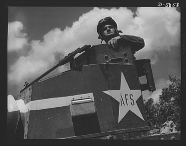 "Fort Knox, Kentucky. Light tanks. The Axis is not going to like the American fighting men it will soon be meeting on the battlefronts of the world. A good example of a man becoming unpopular in Japanese circles is this hardened ""tanker,"" in training with light equipment at Fort Knox, Kentucky"