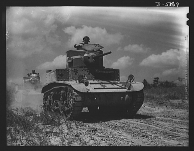 "Fort Knox, Kentucky. Light tanks. The light tanks used at Fort Knox, Kentucky, for training and hardening crews for our armored forces, are graduating tough, competent ""tankers"" who will soon be giving the Axis some pointers on modern warfare"