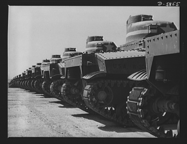 Fort Knox, Kentucky. M-3 tanks. America's armed might grows greater every day. These M-3 tanks, lined up for inspection at Fort Knox, Kentucky, are but a few of the many powerful weapons with which our forces are equipped. These M-3s are being used in training tank crews