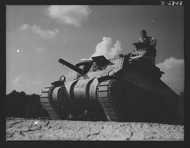 Fort Knox, Kentucky. M-3 tanks. The M-3 tank packs a wallop which the Axis is only beginning to feel. One of these capable monsters, with a tough American crew aboard, is put through its paces in the training area near Fort Knox, Kentucky