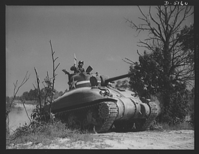 """Fort Knox. M-4 tanks and crews. In the massive cast-steel hull of this M-4 tank, a crew of hard-bitten """"tankers"""" is rehearsing a few fighting tricks at a training school of the armored forces at Fort Knox, Kentucky"""