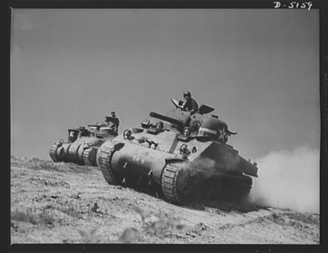 Fort Knox. M-4 tanks and crews. In the new M-4 tanks (right), the designers and the engineers got together to provide fighting advantages over and above those of the older M-3 tanks (left). Location: Fort Knox, Kentucky
