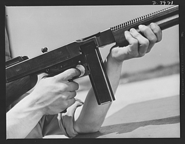 Fort Knox. Machine guns. The .45 caliber Thompson sub-machine gun, familiarly known as the Tommy gun, is a hand weapon for which every branch of the service finds many uses. Its portability and effectiveness makes it a favorite of our modern Army