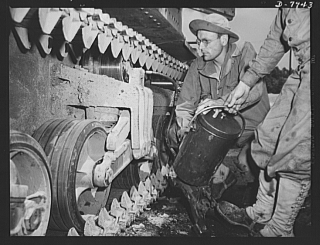 Fort Knox. Maintenance of mechanized equipment. Lubricating the bogie wheels of an M-3 tank at Fort Knox, Kentucky. The Army is very particular about its equipment and one of the first lessons the recruit learns is to give each vehicle the attention it requires