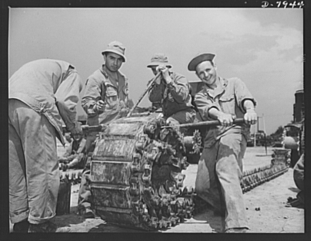 Fort Knox. Maintenance of mechanized equipment. Turning one of the heavy tracks of an M-3 tank at Fort Knox, Kentucky. The Army keeps a large force of trained mechanics busy at the job of servicing and repairing all its motorized equipment
