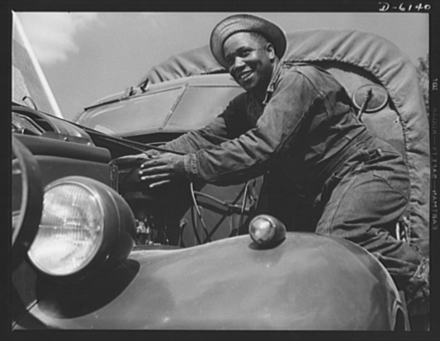 Fort Knox. Negro mechanics. A good job on the air cleaner of an army truck at Fort Knox, Kentucky. This Negro soldier, who serves as truck driver and mechanic, plays an important part in keeping army transport fleets in operation
