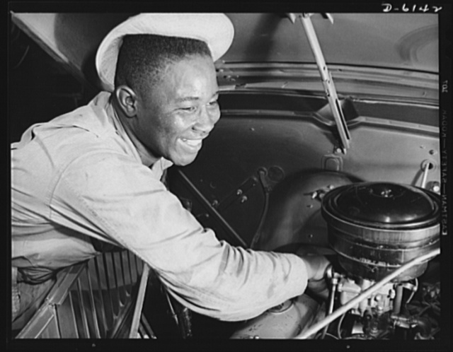 Fort Knox. Negro mechanics. Even army trucks need occasional carburetor adjustment. This Negro soldier, who serves as truck driver and mechanic at Fort Knox, Kentucky, plays an important part in keeping army transport fleets in operation