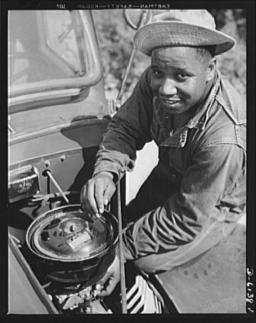 Fort Knox. Negro mechanics. Even army trucks need occasional carburetor adjustments. This Negro soldier, who serves as truck driver and mechanic at Fort Knox, Kentucky, plays an important part in keeping army transport fleets in operation