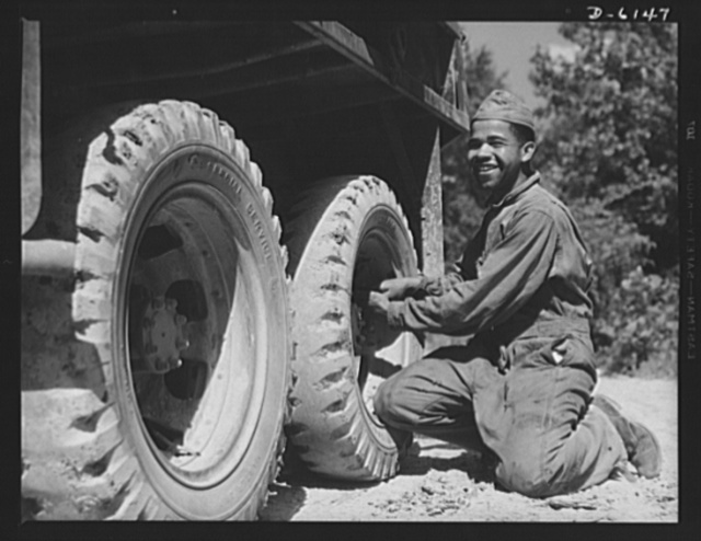 Fort Knox. Negro mechanics. He helps to keep 'em rolling at Fort Knox, Kentucky. This Negro soldier, who serves as truck driver and mechanic, plays an important part in keeping the army's transport fleets in service