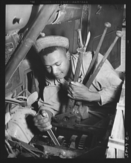 Fort Knox. Negro mechanics. Transmission job on an army truck at Fort Knox, Kentucky. This Negro soldier, who serves as truck driver and mechanic, plays an important part in keeping the army's transport fleets in service