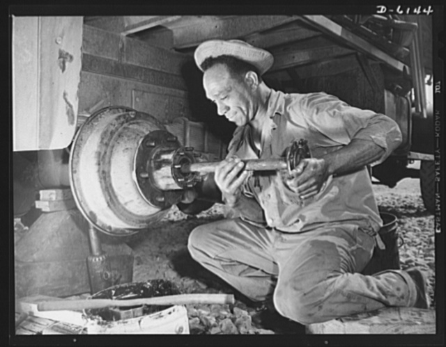 Fort Knox. Negro mechanics. Wheel job on an army truck at Fort Knox, Kentucky. This Negro soldier, who serves as truck driver and mechanic, plays an important part in keeping the army's transport fleets in service