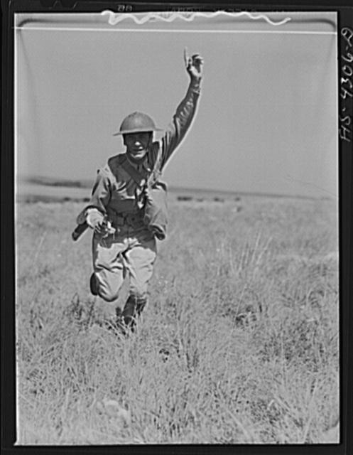 Fort Riley, Kansas. A lieutenant leading an attack during a sham battle
