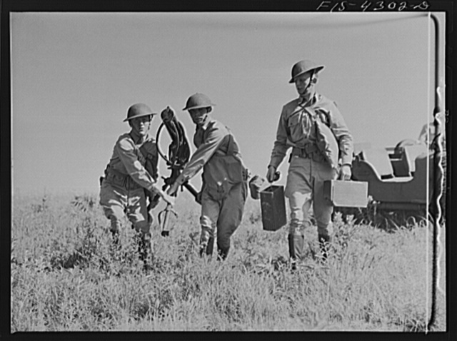 Fort Riley, Kansas. A machine gun unit setting up their gun during a sham battle