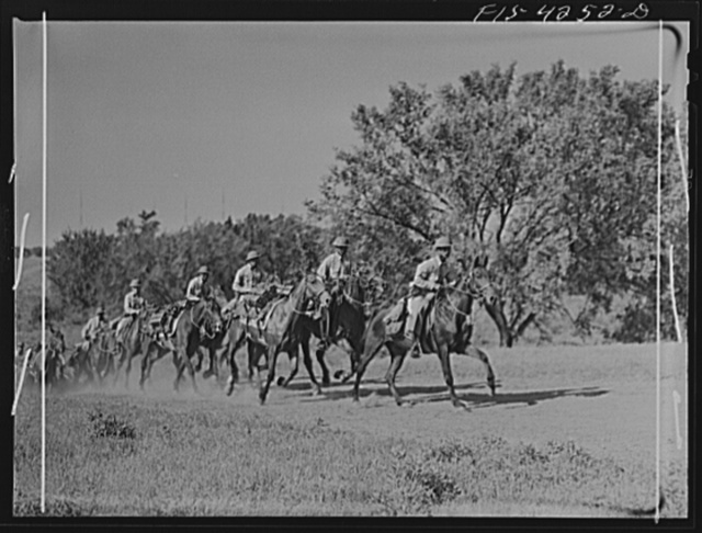 Fort Riley, Kansas. A platoon of cavalry returning to camp after a field problem