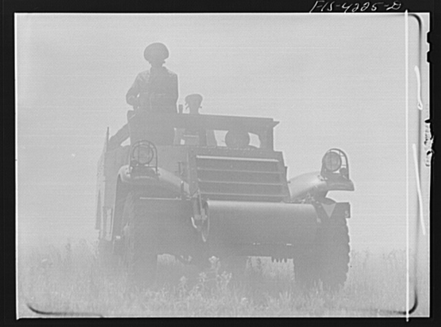 Fort Riley, Kansas. A scout car of a mechanized cavalry reconnaissance unit in a smokescreen during a field problem