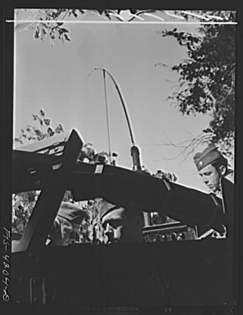 Fort Riley, Kansas. Communicating by radio from a scout car during a field problem of a Signal Corps unit