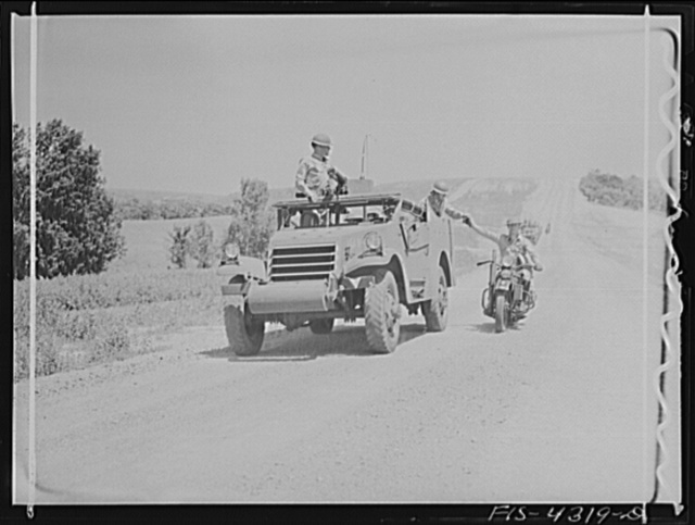 Fort Riley, Kansas. Delivering a message to a moving scout car during a field problem