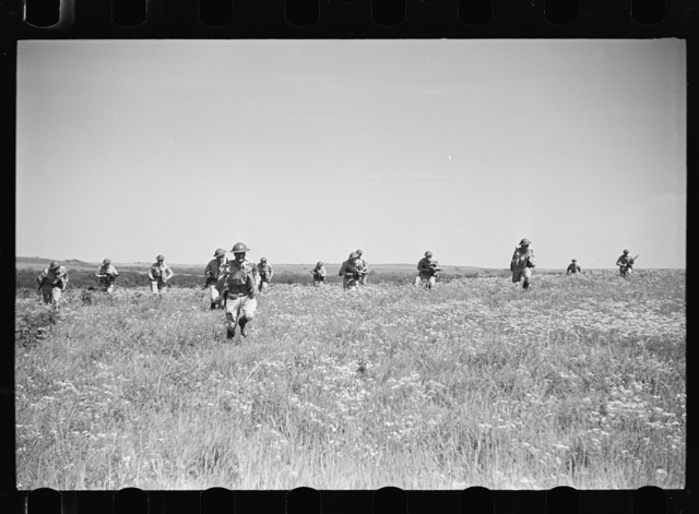 Fort Riley, Kansas. Dismounted attack of a reconnaissance unit during a field problem