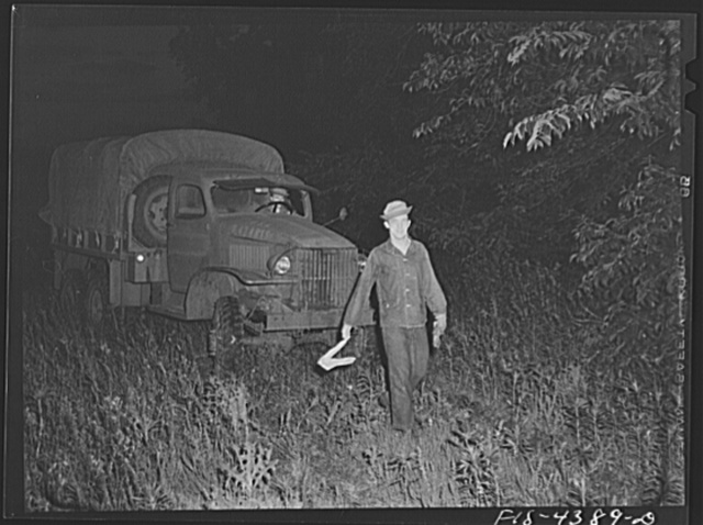 Fort Riley, Kansas. Guiding a truck into bivouac area during a blackout