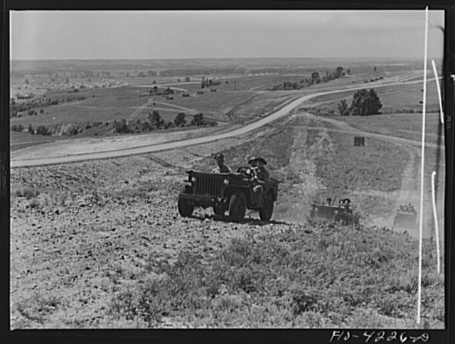 Fort Riley, Kansas. Jeeps of a mechanized cavalry reconnaissance unit going out on a field problem