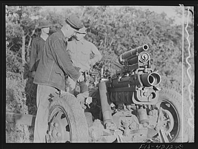 Fort Riley, Kansas. Lining up guns during artillery practice. The small thirty seven mm gun mounted on the howitzer is used only in training