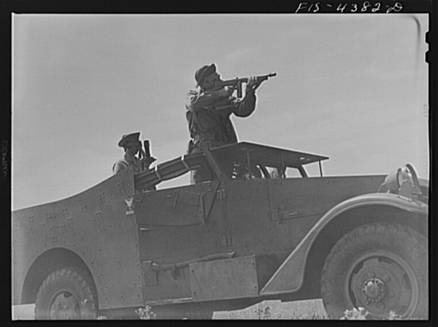 Fort Riley, Kansas. Scout car in a smokescreen during a sham battle