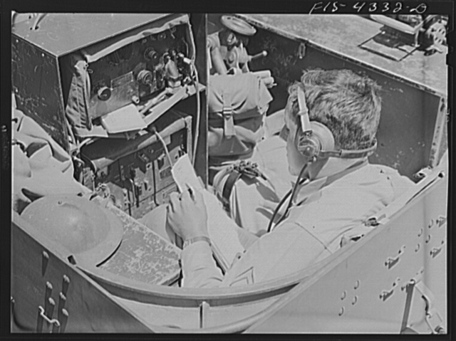 Fort Riley, Kansas. Sending a radio message from a scout car during a sham battle