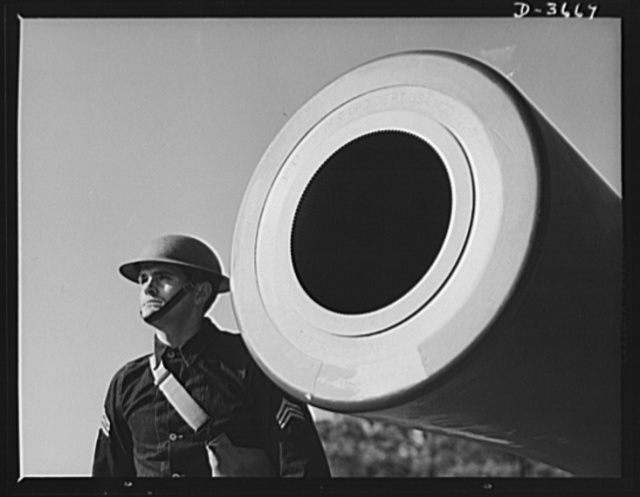 Fort Story coast defense. A sergeant of the CAC [coast artillery Corps?] stands beside the muzzle of a sixteen inch howitzer at Fort Story, Virginia