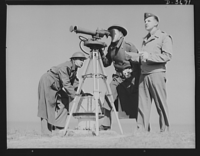 Fort Story coast defense. Men at Fort Story, Virginia operate an azimuth instrument to measure the angle of splash in sea-target practice