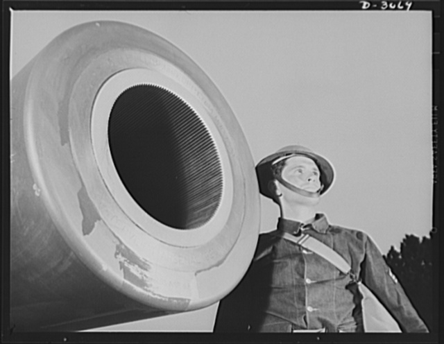 Fort Story coast defense. Representatives of America's men and machines who are out to blast the Axis. Note lands and grooves on interior of muzzle. These bite into the copper rotating band near the base of the projectile and start it spinning as it leaves the gun. This motion keeps the shell on a true course