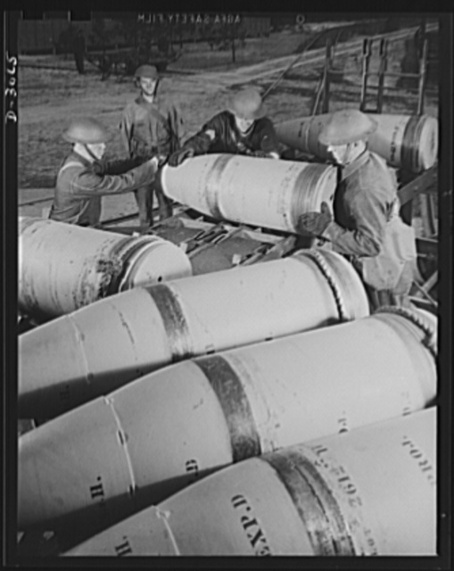 Fort Story coast defense. Soldiers at Fort Story, Virginia, unloading sixteen-inch shells in casemates. The rope tied around the soft copper rotating band