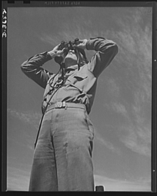 Fort Story cosat defense. Searching the sky for planes. Note the detector apparatus on his chest