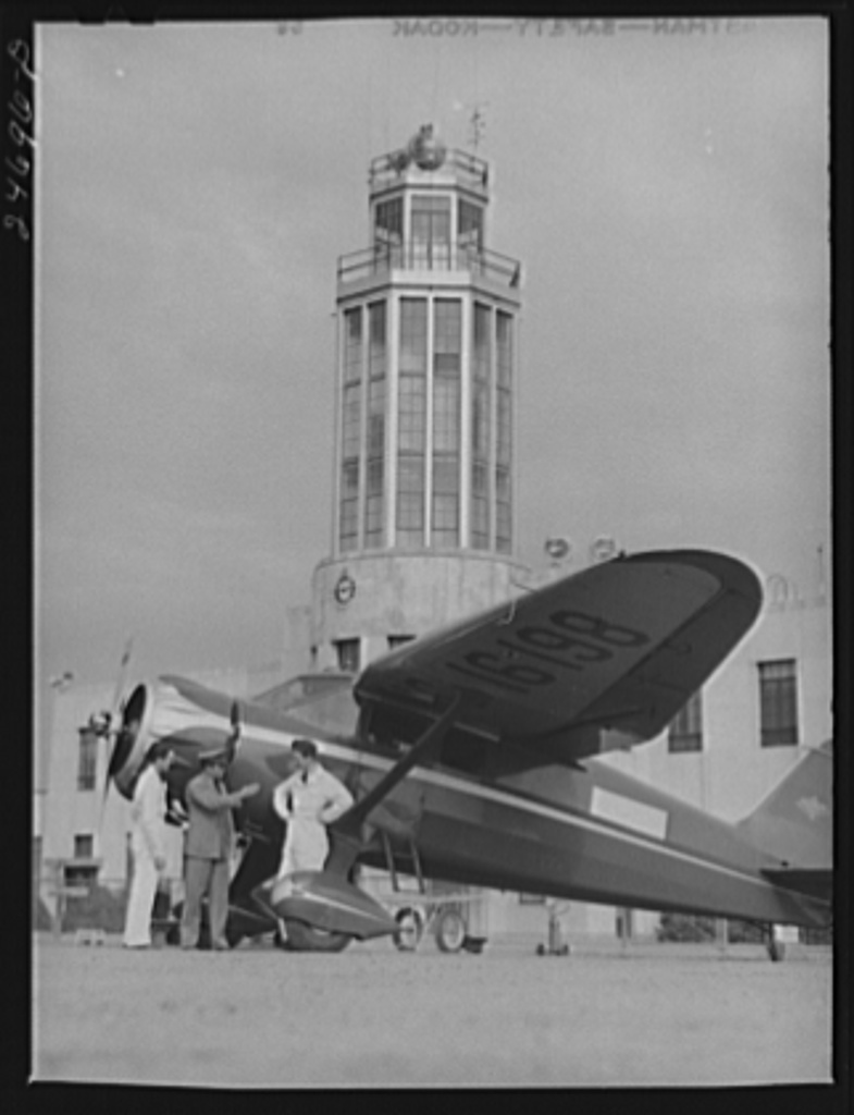 Fort Worth, Texas. Meacham Field. Instructor and students, control tower in background