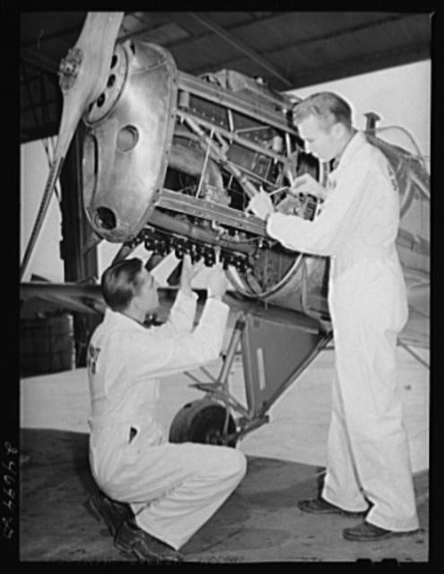 Fort Worth, Texas. Meacham Field. Students repairing plane motor