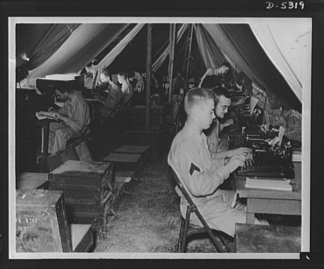Forty-two keys to victory. Somewhere in the field with the U.S. Army, comprehensive clerical work is carried on between maneuvers. Unless those typewriters not essential to the war effort are turned in by civilians to Uncle Sam, the shortage of sufficient machines may materially cripple the speed and facility of army operations