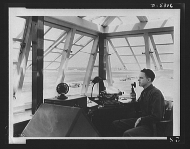 Forty-two keys to victory. Stationed in a control tower, this radio operator dispatches planes, receives weather reports, and transfers everything he hears to necessary permanent record via the typewriter