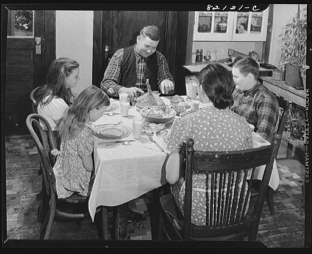 "FSA (Farm Security Administration) client and family sitting down to a well ""balanced meal."" Calvert County, Maryland"