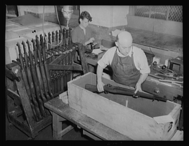 Garand rifles being packed for shipment to troops in training