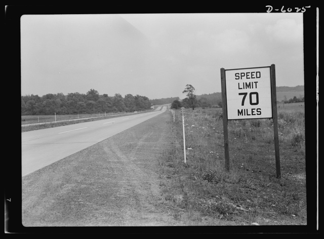 Gasoline rationing. A pre-war sign gives unnecessary warning to wartime motorists, when there are any, as weekday traffic on the Pennsylvania turnpike hits new lows