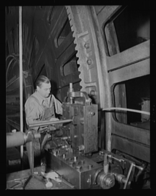 Geared to defense. A 16-inch gun carriage elevating rack has its gears cut by a workman in an eastern arsenal
