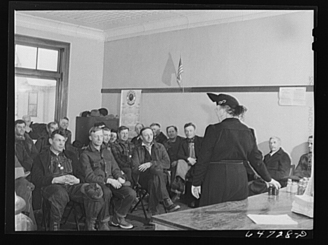 Gladstone, North Dakota. FSA (Farm Security Administration) home supervisor addressing a group of farmers at Food for Victory meeting